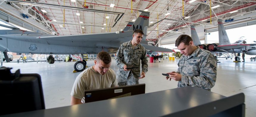 Integrated avionics technicians download data off of an F-15 Eagle's Crash Survivable Memory Unit to check flight control systems at Barnes Air National Guard Base in Massachusetts.