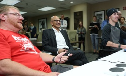 Veteran Roger Brannon, left, plays games with Microsoft CEO Satya Nadella and fellow vet  Matthew Wade.