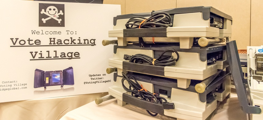Compromised voting machines currently in use in the U.S. on display at DEFCON in April 2018.