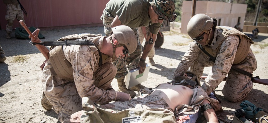 Navy sailors assess a simulated casualty as part of the Field Medical Service Technician Course final exercise on Marine Corps Base Camp Pendleton, California, in September.
