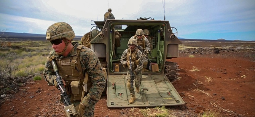 Marines exit an amphibious assault vehicle during a platoon attack as part of exercise Bougainville II on October.