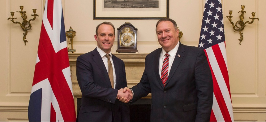 U.K. Foreign Secretary Dominic Raab shakes hands with U.S. Secretary of State Mike Pompeo, right, in London Jan. 29.