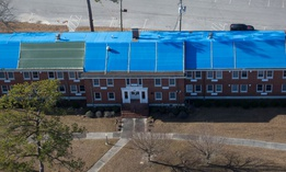 Several buildings remain covered in tarps five months after Hurricane Florence at Camp Lejeune, N.C., Feb. 1, 2019.