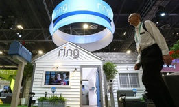 Amazon-owned Ring shows off new products at a booth complete with home and yard during the CES tech show Jan. 7 in Las Vegas.