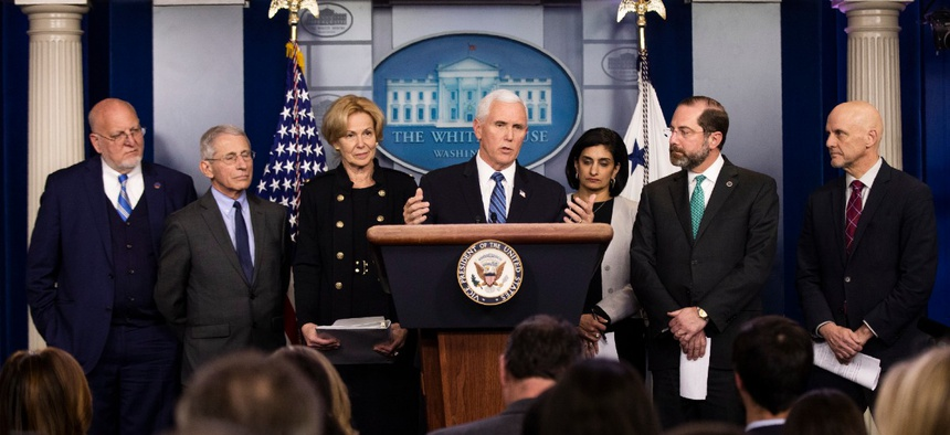 Vice President Mike Pence, center, speaks to reporters about the coronavirus response in the White House March 2.