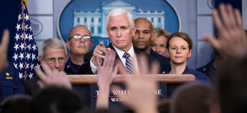 Vice President Mike Pence points to a question as he speaks during a briefing about the coronavirus in the James Brady Press Briefing Room of the White House March 15.