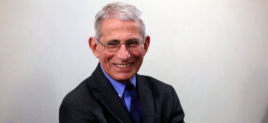 Dr. Anthony Fauci, director of the National Institute of Allergy and Infectious Diseases, wait to speak at press briefing April 13.