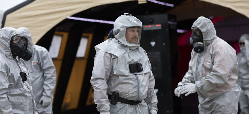 Demonstrators in hazmat suits show how technology can be used to streamline emergency communications and management at the OCR 2019 conference in Perry, Georgia.