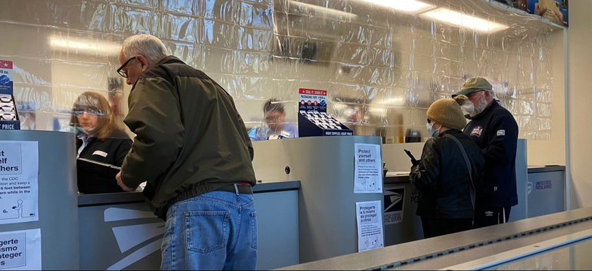Plastic divider separating employees and customers at a Chicago post office during the Coronavirus pandemic in April.