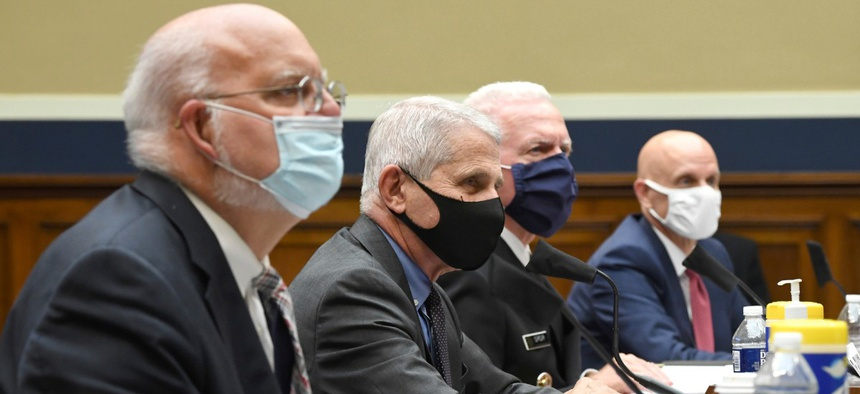 From left to right, Dr. Robert Redfield of the Centers for Disease Control and Prevention, Dr. Anthony Fauci of the National Institute for Allergy and Infectious Diseases, Adm. Brett Giroir of Health and Human Services, and Dr. Stephen Hahn of the Food an