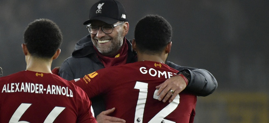 Liverpool's manager Jurgen Klopp, center, celebrates with Liverpool's Trent Alexander-Arnold, left, and Liverpool's Joe Gomez at the end of the English Premier League soccer match in January.