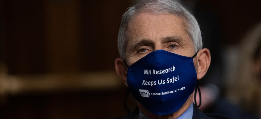 Dr. Anthony Fauci listens during a Senate committee hearing on the federal government response to COVID-19 Capitol Hill on Sept. 23.