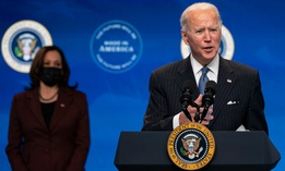 President Joe Biden answers questions from reporters in the South Court Auditorium on the White House complex Jan. 25.